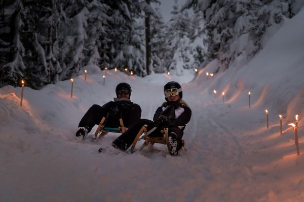 Tobogganing in the torchlight